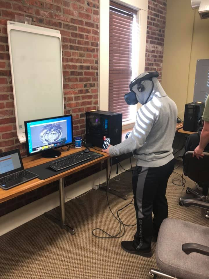 Student standing up wearing virtual reality gear