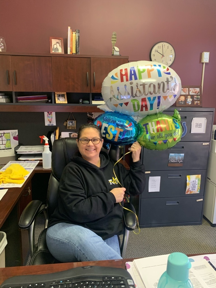 Marnie Lindsay with administrative assistant day balloons